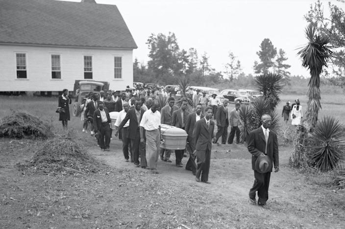 "<span class=""caption"">A funeral held in July 1945 for two victims of the Ku Klux Klan, George Dorsey and his sister, Dorothy Dorsey Malcolm, of Walton County, Georgia, held at the Mt. Perry Baptist Church Sunday. </span> <span class=""attribution""><a class=""link rapid-noclick-resp"" href=""https://www.gettyimages.com/detail/news-photo/the-funeral-for-two-of-the-victims-in-the-july-25th-news-photo/514970326?adppopup=true"" rel=""nofollow noopener"" target=""_blank"" data-ylk=""slk:Bettman via Getty"">Bettman via Getty</a></span>"