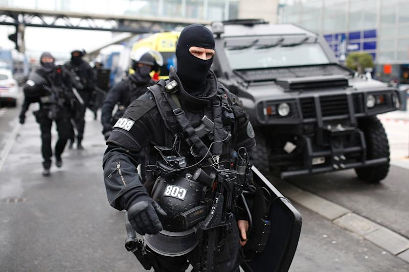 RAID police unit officers secure the area at the Paris' Orly airport on March 18, 2017 following the shooting of a man by French security forces