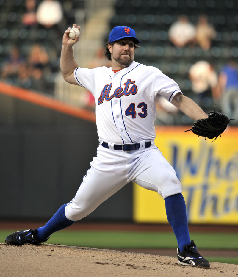 New York Mets starting pitcher R.A. Dickey throws against the Pittsburgh Pirates in the first inning of a baseball game, Tuesday, May 31, 2011, in New York. (AP Photo/Kathy Kmonicek)