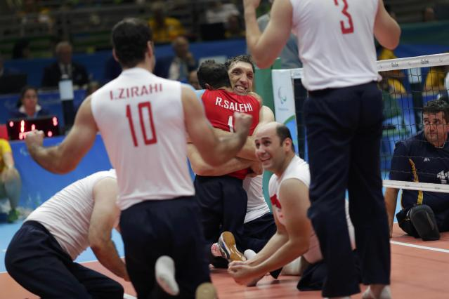 2016 Rio Paralympics - Sitting Volleyball - Final - Men's Gold Medal Match - Riocentro Pavilion 6 - Rio de Janeiro, Brazil - 18/09/2016. Players of team Iran celebrate. REUTERS/Ueslei Marcelino FOR EDITORIAL USE ONLY. NOT FOR SALE FOR MARKETING OR ADVERTISING CAMPAIGNS.