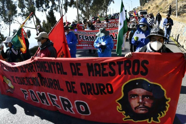 Workers march from El Alto to La Paz to protest the health, education and labor policies of Bolivian President Jeanine Anez's right-wing government