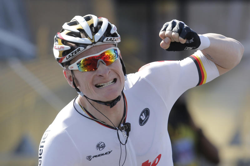 Andre Greipel of Germany celebrates as he crosses the finish line to win the sixth stage of the Tour de France cycling race over 176.5 kilometers (110.3 miles) with start in Aix-en-Provence and finish in Montpellier, southern France, Thursday July 4, 2013. (AP Photo/Laurent Cipriani)