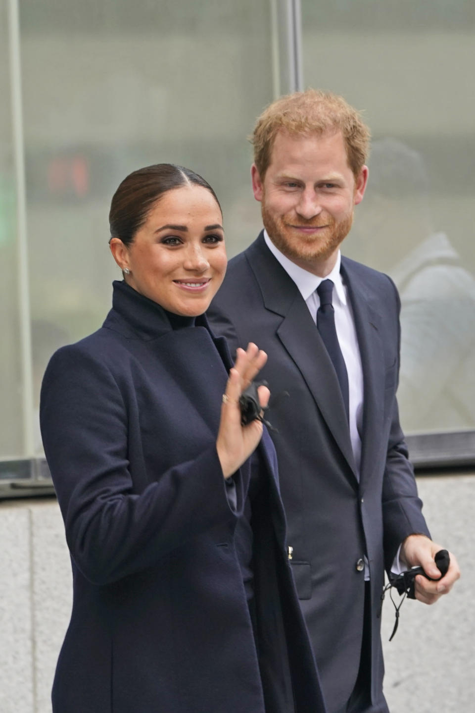 Meghan Markle and Prince Harry pose for pictures after visiting the observatory in One World Trade in New York, Thursday, Sept. 23, 2021. The Duke and Duchess of Sussex got a hawk's-eye view of New York City with a visit to the rebuilt World Trade Center's signature tower. (AP Photo/Seth Wenig)