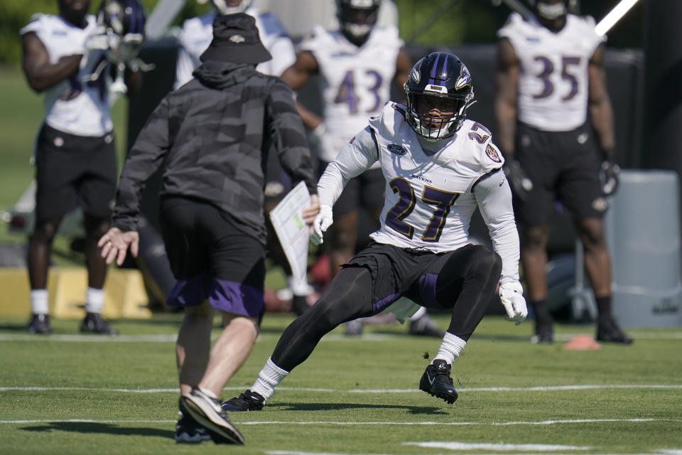 Baltimore Ravens running back J.K. Dobbins works out during the team's NFL football training, Tuesday, June 15, 2021, in Owings Mills, Md. (AP Photo/Julio Cortez)