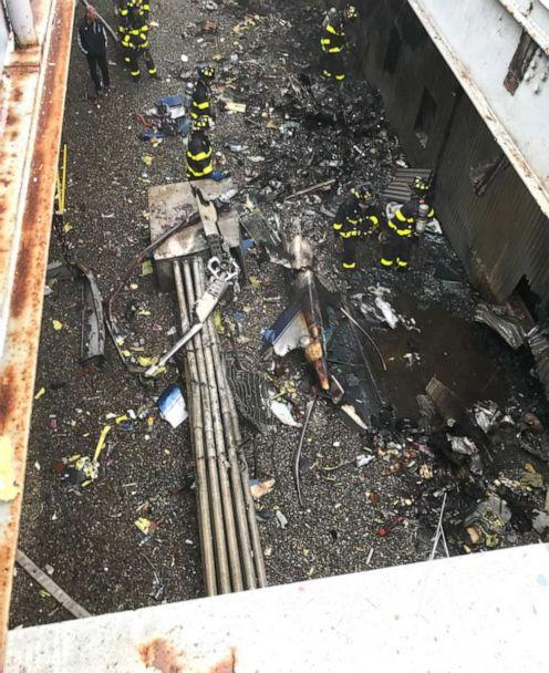 PHOTO: Firefighters at the scene of a helicopter crash at 787 7th Ave. in New York, June 10, 2019. (FDNY )