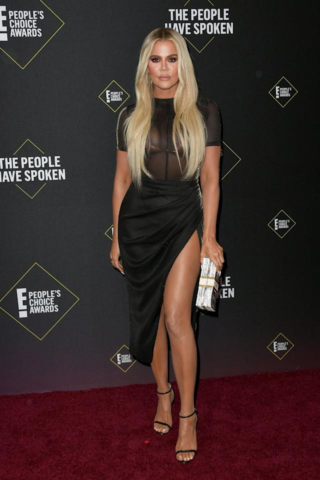 <p>Khloé Kardashian opted for a hip-high split skirt with a totally sheer shirt up top, perfectly nailing the 'sexy chic' brief. Go Khlo!</p>
