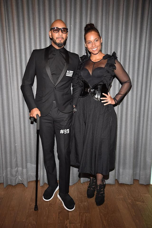 <p>Singer Alicia Keys and her husband, Swizz Beatz, both wore black glam looks to the 2017 Brooklyn Artists Ball on April 3. (Photo: Getty Images) </p>