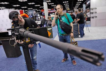 A man looks through the sights of a .50 caliber rifle at the Ohio Ordinance Works during the National Rifle Association (NRA) annual meeting in Indianapolis, Indiana, U.S., April 28, 2019. REUTERS/Lucas Jackson