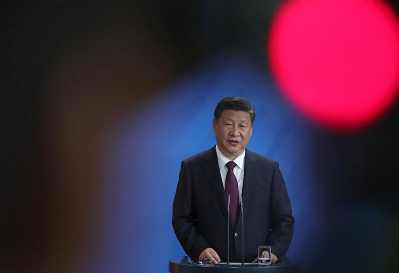 China's Xi threatens Taiwan with force but also seeks peaceful 'reunification'