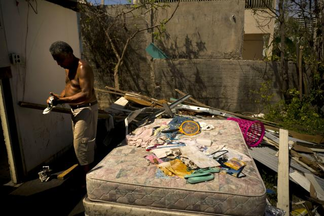 <p>Efrain Diaz Figueroa cleans his hands after repairing the roof of the house of his sister destroyed by Hurricane Maria in San Juan, Puerto Rico, Monday, Oct. 9, 2017. Figueroa, who was visiting for a month at her sister Eneida's house when the Hurricane Maria hit the area, also lost her home in the Arroyo community. He waits for a relative to come from Boston and take him to Boston. He says that he is 70 years old and all his life working can't continue in these conditions in Puerto Rico. (Photo: Ramon Espinosa/AP) </p>