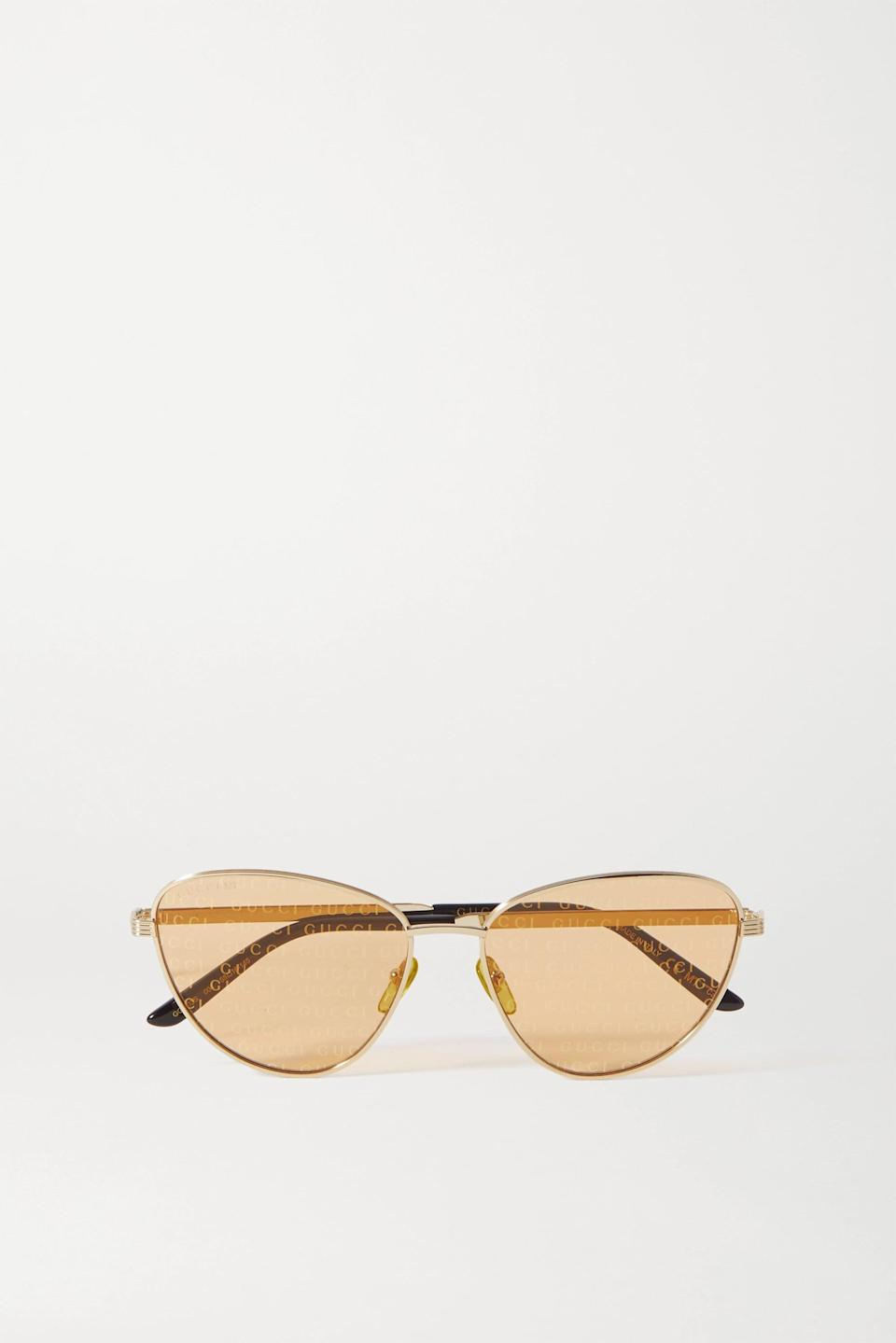 <p><span>Gucci Gold Cat-Eye Gold-Tone and Acetate Sunglasses</span> ($480)</p>