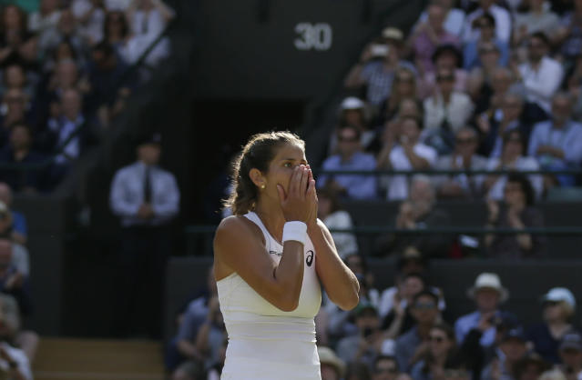 Julia Goerges of Germany celebrates defeating Kiki Bertens of the Netherlands in their women's quarterfinal match at the Wimbledon Tennis Championships in London, Tuesday July 10, 2018. (AP Photo/Tim Ireland)