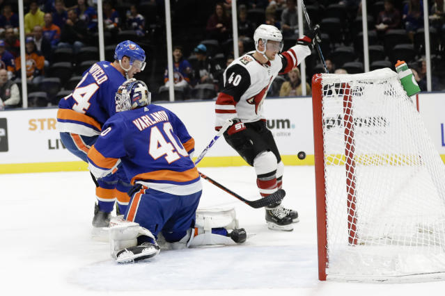 Arizona Coyotes' Michael Grabner (40) skates past New York Islanders goaltender Semyon Varlamov (40) and Scott Mayfield (24) after scoring a goal during the first period of an NHL hockey game Thursday, Oct. 24, 2019, in Uniondale, N.Y. (AP Photo/Frank Franklin II)