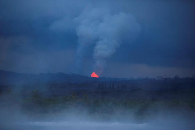 <p>Lava erupts from Fissure Number 8 in Leilani Estates during ongoing eruptions of the Kilauea Volcano in Hawaii, June 7, 2018. (Photo: Terray Sylvester/Reuters) </p>