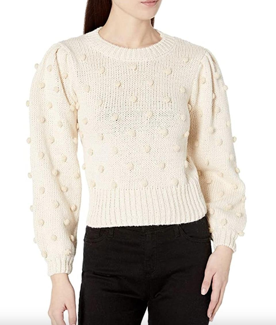 <p>This <span>ASTR the Label Aidy Pom Knit Sweater</span> ($71) feels textured and fun, thanks to the pom pom inserts. It's great for a kid's birthday party or an office celebration.</p>