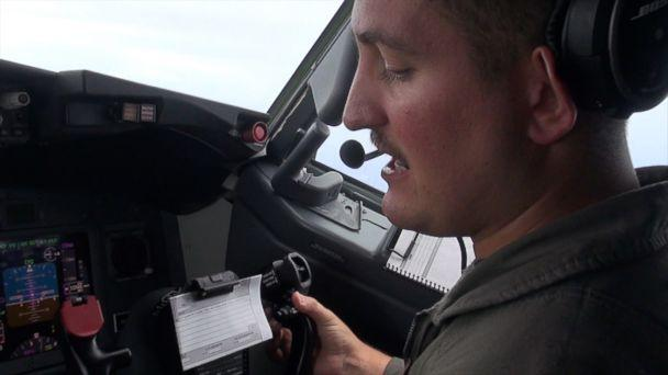 PHOTO: A member of the U.S. Navy Maritime Patrol Squadron Four radios a response to a warning from Chinese personnel, over the South China Sea, on Sep. 6, 2018. (ABC News)