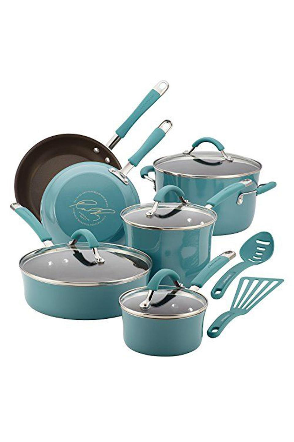 """<p><strong>Rachael Ray</strong></p><p>amazon.com</p><p><strong>$159.99</strong></p><p><a href=""""https://www.amazon.com/dp/B00JYHNNYK?tag=syn-yahoo-20&ascsubtag=%5Bartid%7C10049.g.29194509%5Bsrc%7Cyahoo-us"""" rel=""""nofollow noopener"""" target=""""_blank"""" data-ylk=""""slk:Shop Now"""" class=""""link rapid-noclick-resp"""">Shop Now</a></p><p>Cooking can be a hassle when you have a shared kitchen, but if they're in their own apartment, they'll definitely use a cookware set—especially one in a gorge blue shade.</p>"""