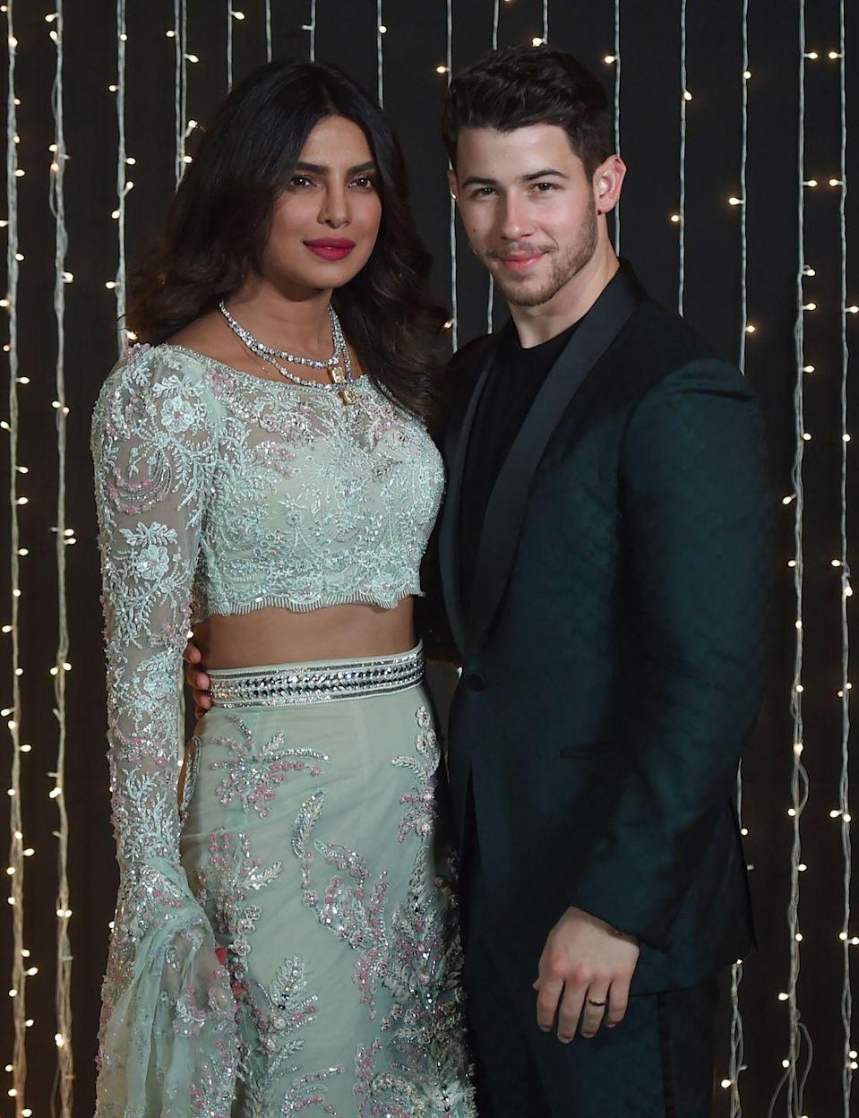 <p>The couple attend a reception in Mumbai, India a few weeks after they exchange vows.</p>