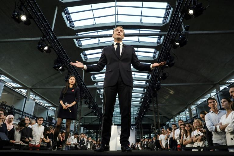 French President Emmanuel Macron speaking to start-up entrepreneurs in Paris on October 9, 2018   delivers a speech as he visits Station F startup campus in Paris, on October 9, 2018