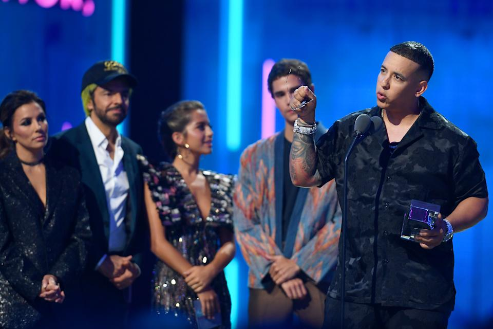 CORAL GABLES, FLORIDA - JULY 18:  Daddy Yankee accepts an award on stage during Premios Juventud 2019 at Watsco Center on July 18, 2019 in Coral Gables, Florida. (Photo by Jason Koerner/Getty Images)