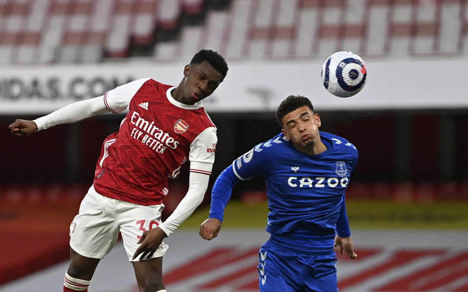 Arsenal's Eddie Nketiah, left, duels for the ball with Everton's Ben Godfrey during the English Premier League soccer match between Arsenal and Everton at the Emirates stadium in London, Friday, Apr 23, 2021. (Justin Setterfield/Pool via AP)