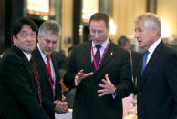 U.S. Defense Secretary Chuck Hagel, right, speaks with Canada's National Defense Minister Peter Gordon MacKay, second right, as Japan's Defense Minister Itsunori Onodera, left, and Australian Defense Minister Stephen Smith, second left, listen at the opening session of the International Institute for Strategic Studies Shangri-la Dialogue, or IISS Asia Security Summit on Friday, May 31, 2013 in Singapore. The meetings will be held from May 31 to June 2. (AP Photo/Wong Maye-E)