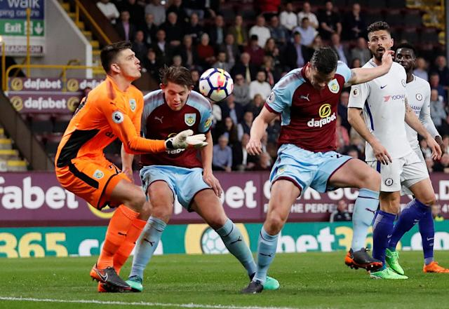 "Soccer Football - Premier League - Burnley vs Chelsea - Turf Moor, Burnley, Britain - April 19, 2018 Burnley's Nick Pope, James Tarkowski and Kevin Long in action Action Images via Reuters/Andrew Boyers EDITORIAL USE ONLY. No use with unauthorized audio, video, data, fixture lists, club/league logos or ""live"" services. Online in-match use limited to 75 images, no video emulation. No use in betting, games or single club/league/player publications. Please contact your account representative for further details."