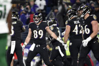 Baltimore Ravens tight end Mark Andrews (89) celebrates with quarterback Lamar Jackson (8) after they connected for a touchdown pass during the first half of an NFL football game against the New York Jets, Thursday, Dec. 12, 2019, in Baltimore. (AP Photo/Gail Burton)