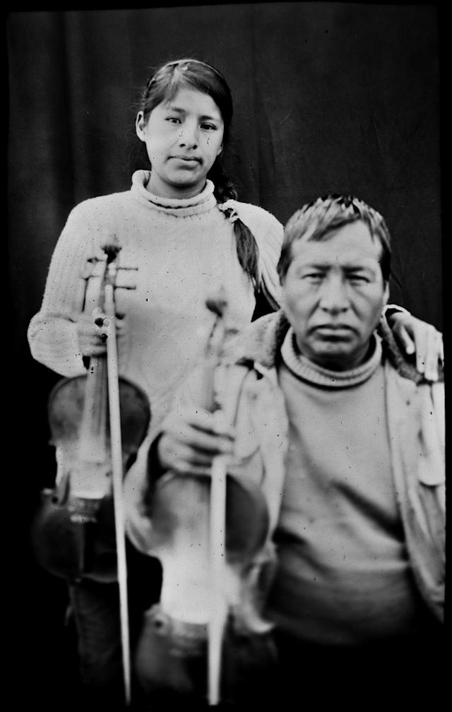 <p>Filament Wilca, 54, and his daughter Laura Wilca, 23, pose for a portrait in the Sinakara Valley, in Peru's Cuzco region, during the Qoyllur Rit'i festival, translated from the Quechua language as Snow Star. The father and daughter are violinists representing the Quispicanchis nation. (Photo: Rodrigo Abd/AP) </p>