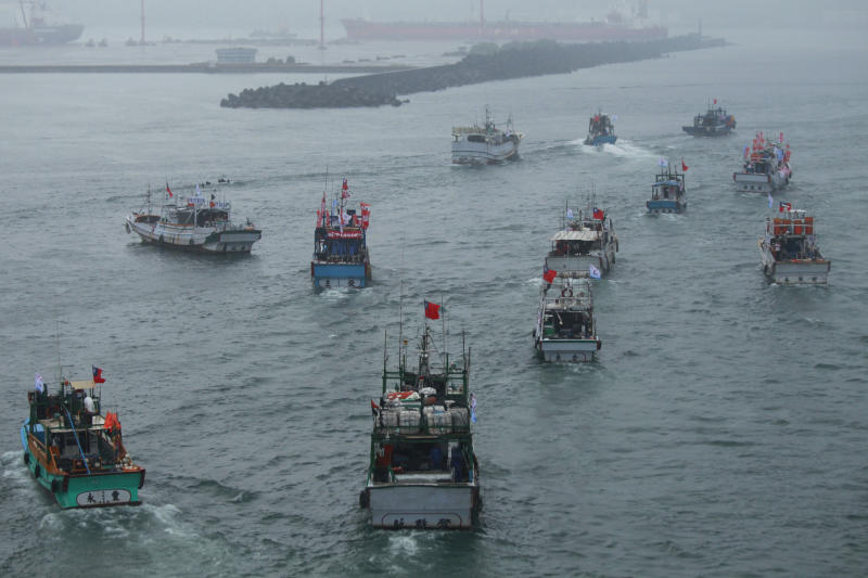 Several dozen fishing boats flying Taiwanese national flags set out from the Suao harbor, northeastern Taiwan, to the disputed islands in the East China Sea, Monday, Sept. 24, 2012. The islands, called Senkaku in Japan and Diaoyu in China, are controlled by Japan but also claimed by China and Taiwan, and have been a key part of simmering regional tensions over rival territorial claims. (AP Photo/Wally Santana)