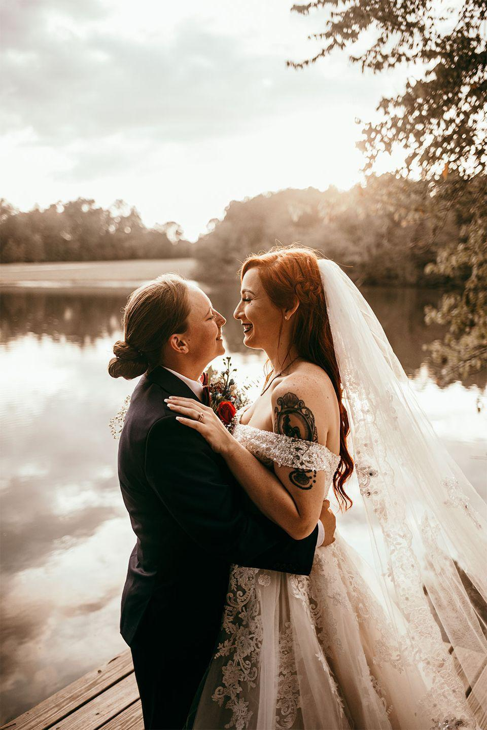 <p>The brides took portraits next to the water in Lagrange, Georgia on their fall wedding day on October 6, 2019.</p>
