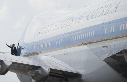 US President Barack Obama waves from Air Force One