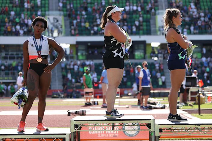 Gwen Berry (L) turns away from US flag during the national anthem on day nine of the 2020 US Olympic Track & Field Team Trials in Eugene, Oregon (Getty Images)