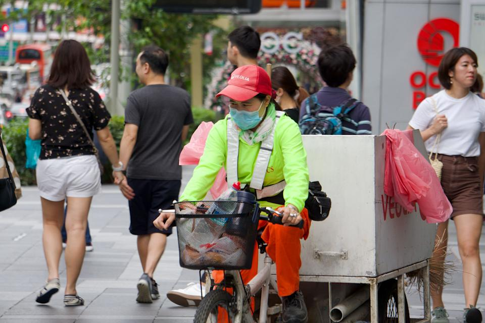 A cleaner seen wearing a face mask along Orchard Road on 9 February 2020. (PHOTO: Dhany Osman / Yahoo News Singapore)