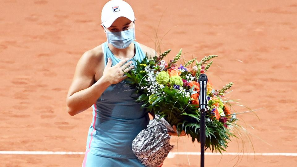 Ash Barty, pictured here with a bouquet of flowers for her 25th birthday.