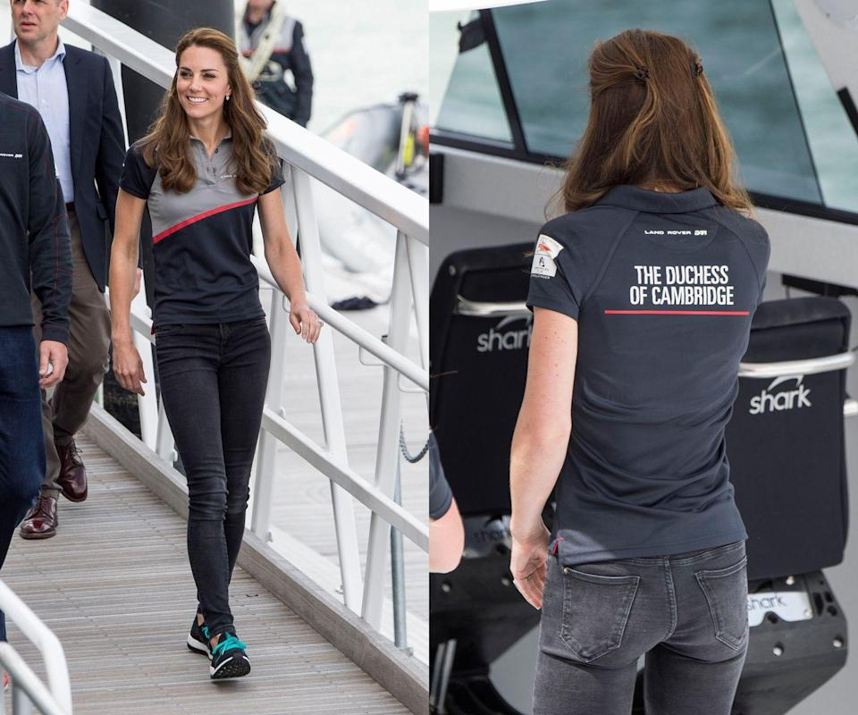<p>The Duchess attended America's World Cup Series in Portsmouth, England, wearing dark gray jeans and her own customized polo, plus sneakers. </p>
