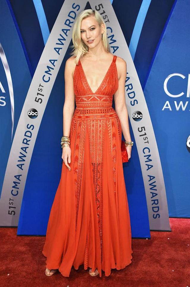 <p>Having just run the New York Marathon, Kloss cleaned up nicely in a sheer red dress. (Photo: Getty Images) </p>