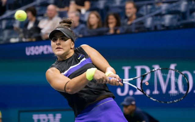 Bianca Andreescu of Canada hits a return against Elise Mertens of Belgium. (DON EMMERT/AFP/Getty Images)