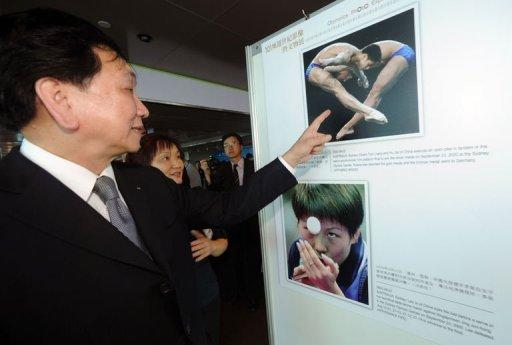Wu Ching-kuo, a member of the International Olympic Committee (IOC), looks at sports photographs