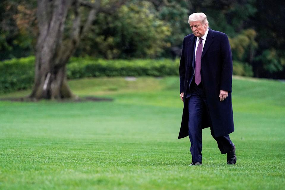 Donald Trump walks from Marine One as he returns from Bedminster, New Jersey on the South Lawn of the White House in Washington, 1 October (REUTERS)