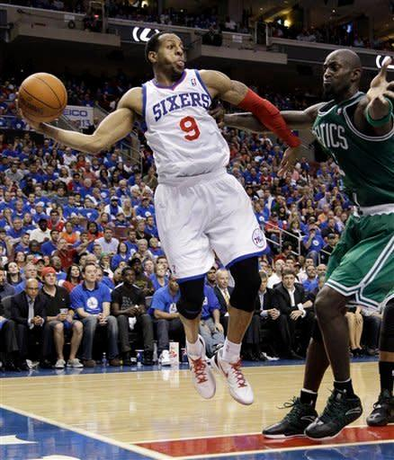 Philadelphia 76ers' Andre Iguodala tries to pass the ball as Boston Celtics' Kevin Garnett defends during the second half of Game 6 of an NBA basketball Eastern Conference semifinal playoff series, Wednesday, May 23, 2012, in Philadelphia. Philadelphia won 82-75. (AP Photo/Matt Slocum)