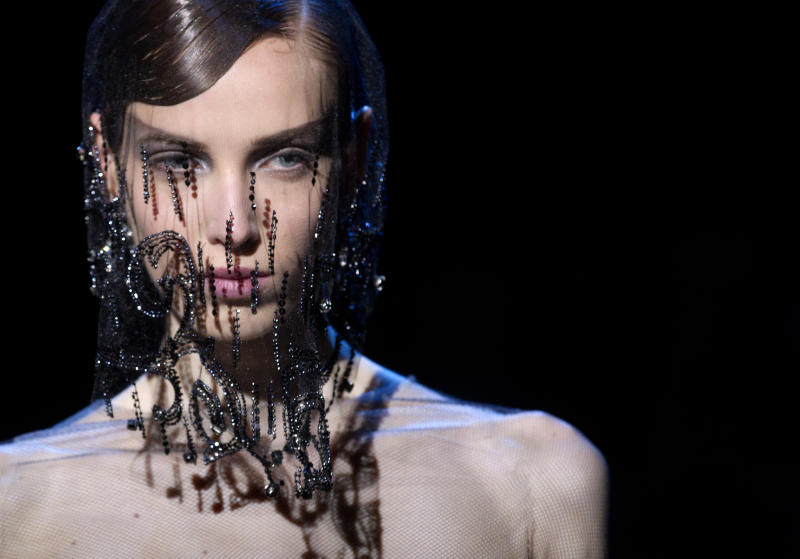 A model wears a creation by Italian designer Giorgio Armani as part of his presentation for Women's Fall Winter 2013 haute couture fashion collection, in Paris, France, Tuesday, July 3, 2012. (AP Photo/Jacques Brinon)
