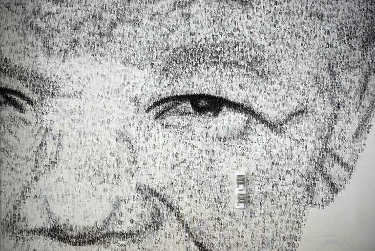 """A close-up detail of Shanghai-based Belgian artist Phil Akashi's portrait of South African peace icon and former boxer Nelson Mandela, which he forged by pounding the wall 27,000 times with a boxing glove bearing Chinese character for """"freedom"""", in Shanghai, on August 1, 2013"""