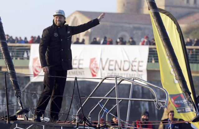 British sailor Alex Thomson waves as he completes the solo round-the-world Vendee Globe sailing race in second place, as he arrives in the port of Les Sables d'Olonne, France, January 20, 2017. REUTERS/Regis Duvignau