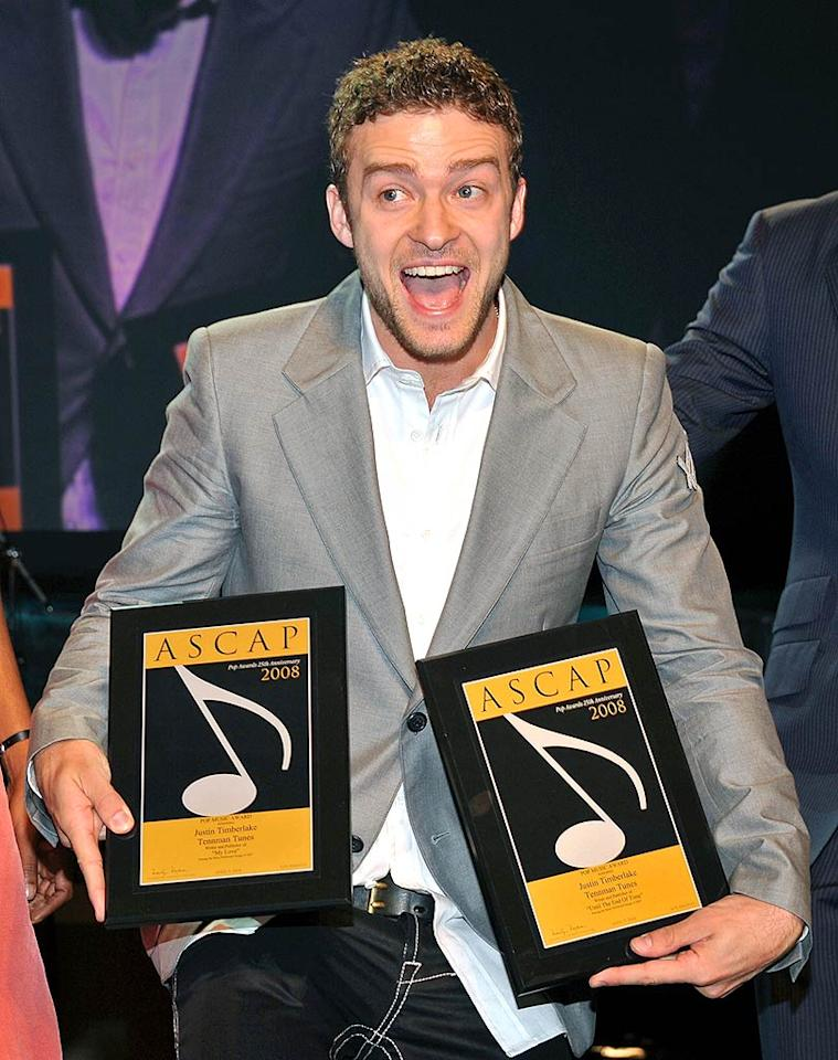 "Justin Timberlake is all smiles as he poses with two of the five ASCAP awards he got to take home at the end of the evening. Lester Cohen/<a href=""http://www.wireimage.com"" target=""new"">WireImage.com</a> - April 9, 2008"