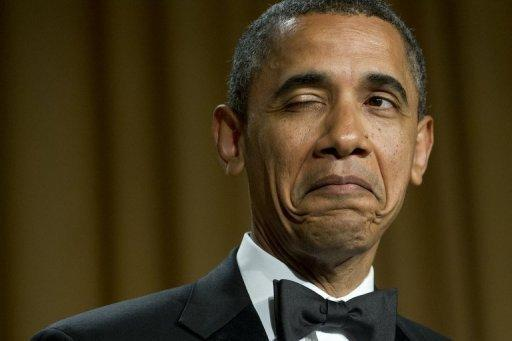 US President Barack Obama winks as he tells a joke during the White House Correspondents Association Dinner on April 28. Obama lampooned Mitt Romney's wealth and mimed a shaggy dog story about his foe, striking a rare light note in the bitter White House race