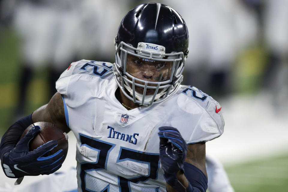 FILE - In this Nov. 29, 2020, file photo, Tennessee Titans running back Derrick Henry (22) runs down the sidelines for a touchdown during an NFL football game against the Indianapolis Colts in Indianapolis. Fresh off becoming just the eighth man to run for at least 2,000 yards, Henry now has a 17th game giving him a chance at Eric Dickerson's league record of 2,105 yards set in 1984. (AP Photo/Zach Bolinger, File)