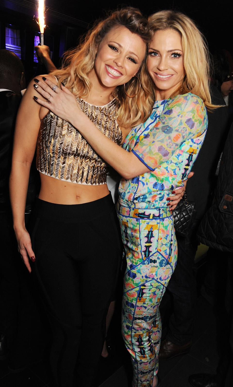 LONDON, ENGLAND - MARCH 02:  (EMBARGOED FOR PUBLICATION IN UK TABLOID NEWSPAPERS UNTIL 48 HOURS AFTER CREATE DATE AND TIME. MANDATORY CREDIT PHOTO BY DAVE M. BENETT/GETTY IMAGES REQUIRED) (L-R) Kimberley Walsh and Sarah Harding of Girls Aloud attend their London Ten - The Hits Tour after party at Whisky Mist Club on March 02, 2013 in London, England. (Photo by Dave M. Benett/Getty Images)