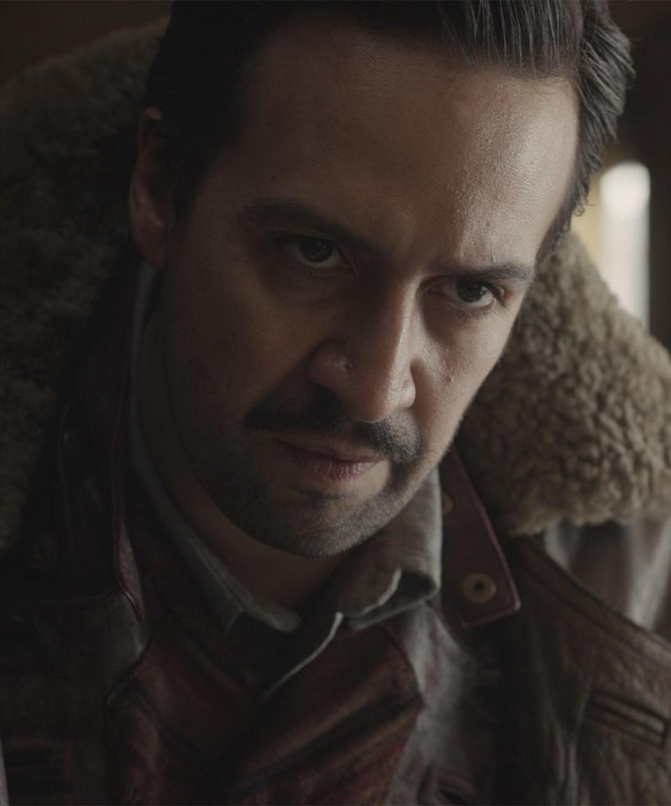 """<strong><h2>Lin-Manuel Miranda Plays Lee Scoresby</h2></strong> <br> <strong>Who Is Lee?<br></strong>A skilled """"aëronaut"""" balloonist from the country of Texas. His dæmon is a female arctic hare by the name of named Hester. We probably won't see Lee right away in the show, but as we dive deeper into the story, he is hired by John Faa and the Gyptians to help Lyra save the kidnapped children. <br> <br> <strong>Where You've Seen Miranda<br></strong>If there's anyone who's going to save the world right now, it's Miranda. At this point, he's a double, triple, and quadruple threat between stage, screen, television, and also revamping Disney animated classics (he wrote the songs for <em>Moana</em> and is helping out with the upcoming <em>The Little Mermaid</em>). Also very importantly, he plays Amy Santiago's brother on <em>Brooklyn Nine-Nine</em>. <span class=""""copyright"""">Photo: Courtesy of HBO.</span>"""
