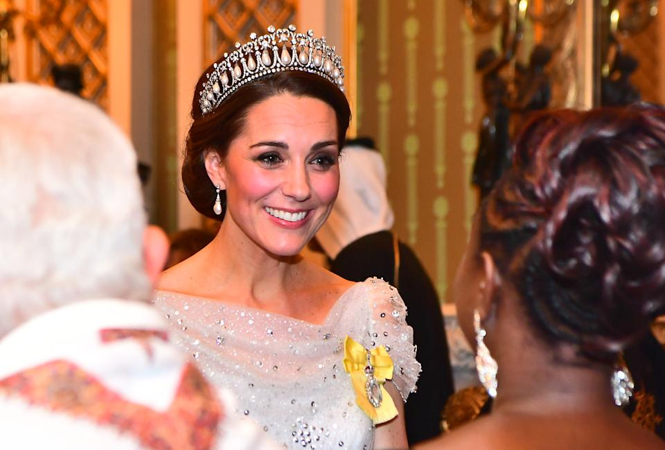 Catherine, Duchess of Cambridge wears a tiara while greeting guests at an evening reception for members of the Diplomatic Corps at Buckingham Palace on December 04, 2018 in London, England